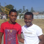 Familiy integration worker Temesgen Degefaw (right) with former street child